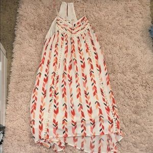 White sun dress with multi-colored arrows